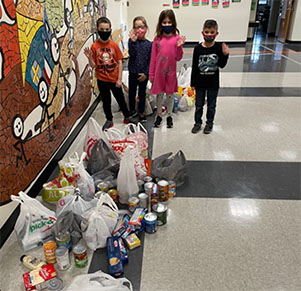 Select Forge Students make donation to Caring Cupboard